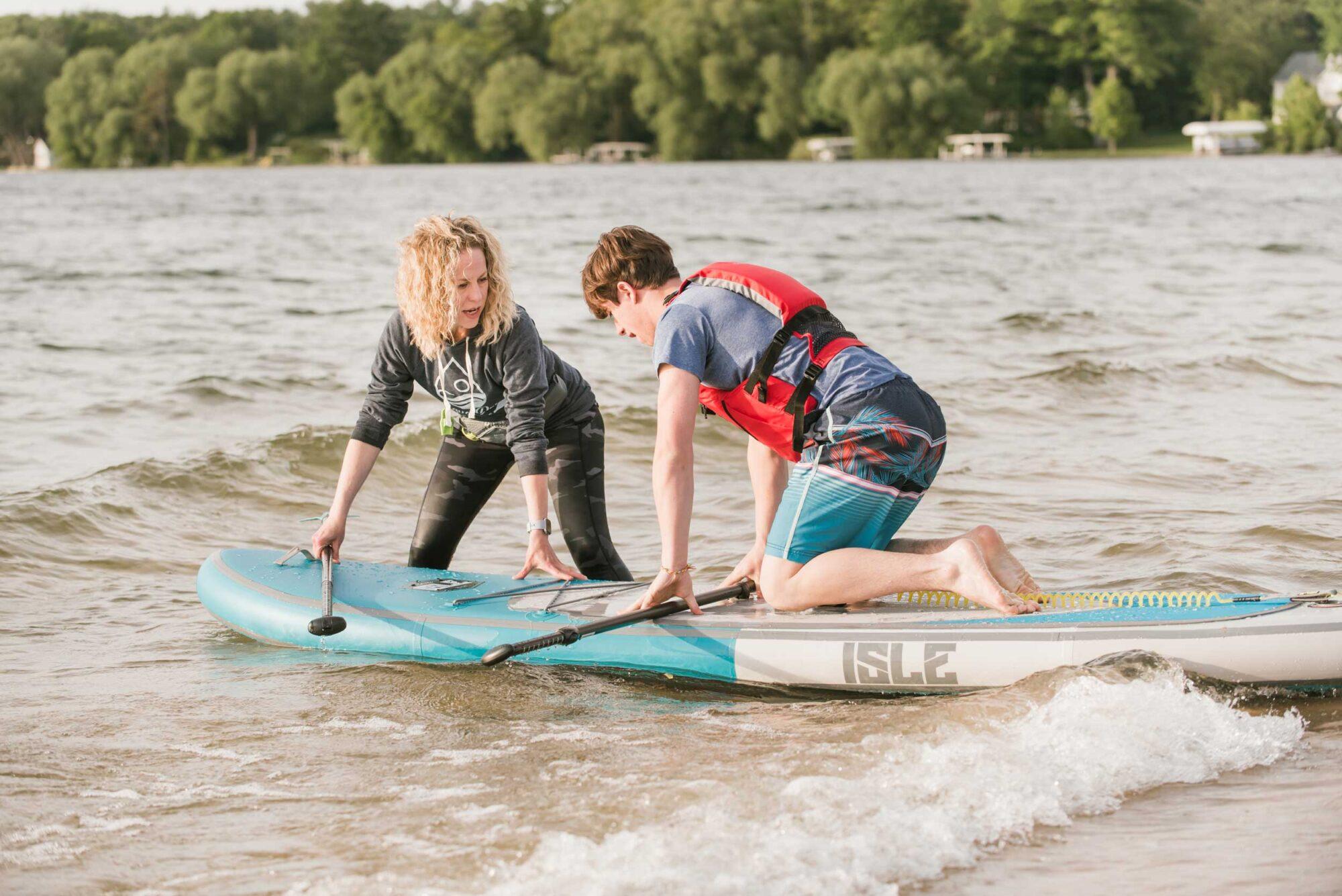 Acqua Dolce Paddle Holli instructing student on paddleboard